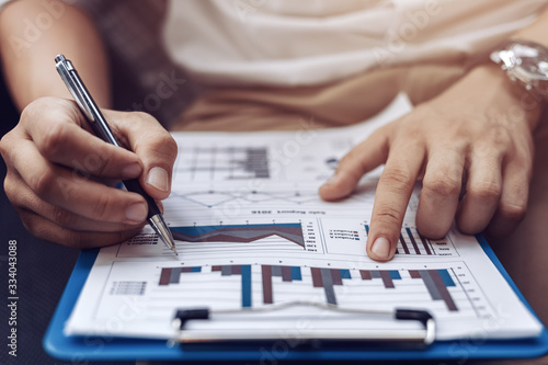 Fotografia Businessman hold pen and working calculate data