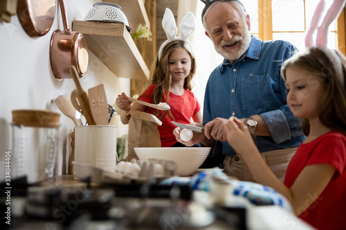 Photo Delighted grandpa laughing with kids stock photo
