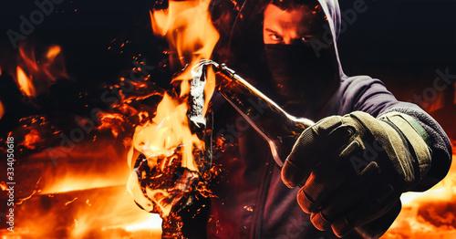 Protestant holding burning molotov cocktail. Fototapet