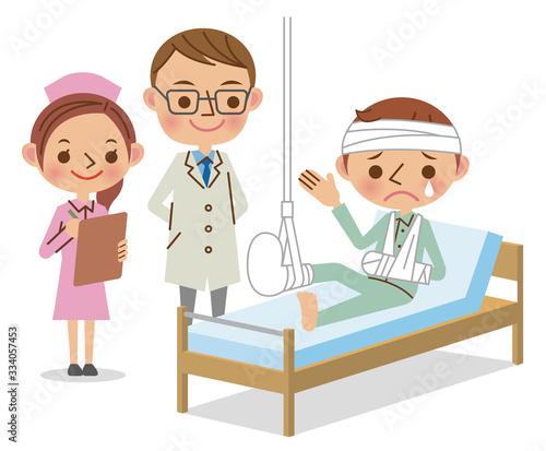 足を骨折して入院している患者とそれを見守る医師、看護師 Canvas Print