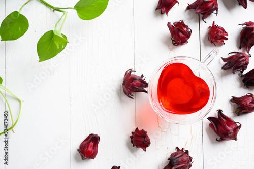 Fényképezés Roselle juice on wooden background, herbal organic tea for good healthy