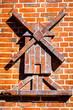 canvas print picture - Backsteinfassade mit Windmühlenornament