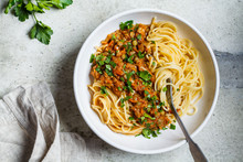 Vegetarian Lentils Bolognese Pasta With Parsley In White Dish, Top View. Healthy Vegan Food Concept.