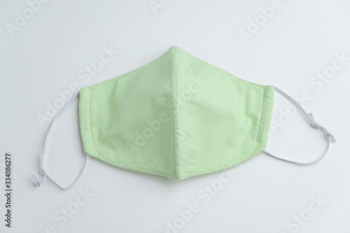 Valokuvatapetti design of face mask handmade sewing from fashion fabric cotton cloth on white ba