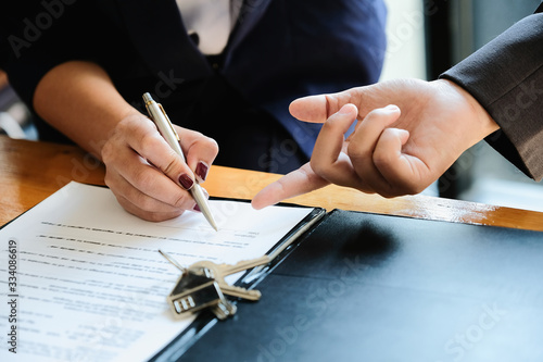 Real estate agent offer hand for customer sign agreement contract signature for buy or sell house Canvas Print