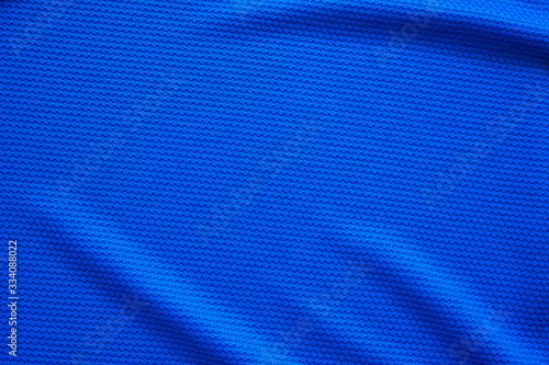 Fotografiet Blue football jersey clothing fabric texture sports wear background, close up to