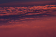 Colorful Saturated Bright Pink, Orange And Purple Clouds With Waves In Sunset Heaven As Abstract Background, Lush Lava Color.
