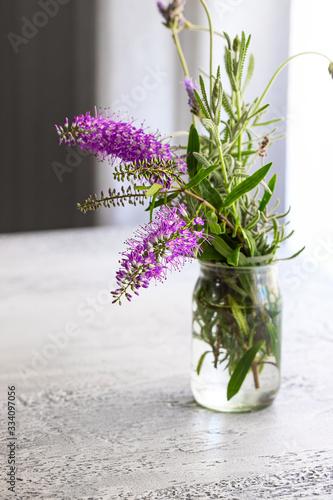 Fototapeta Fresh lavender flower bouquet in vase on the table. obraz na płótnie