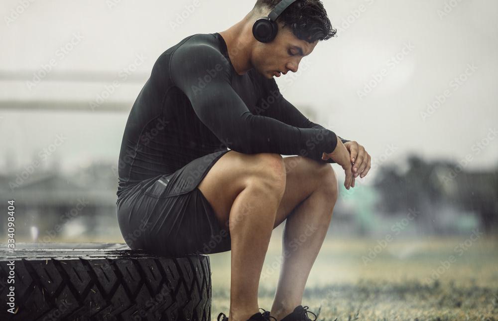 Fototapeta Athlete resting after intense cross training