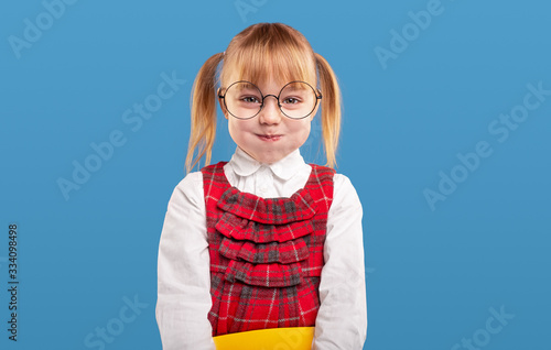 Valokuva Cute schoolgirl with puffed cheeks