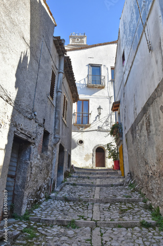 A narrow street between the old houses of Castelvetere sul Calore, village in th Wallpaper Mural