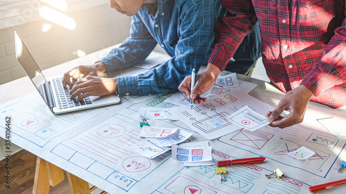 Obraz na plátně close up male asian ui/ux designers working and designing a user interface for w