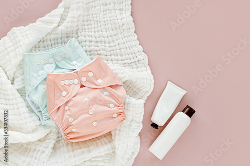 Fényképezés Baby set of cloth diaper with insert laying  and muslin swaddle blanket