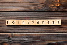 Forgiveness Word Written On Wood Block. Forgiveness Text On Table, Concept