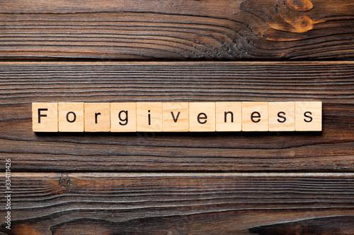 Fotografia, Obraz forgiveness word written on wood block