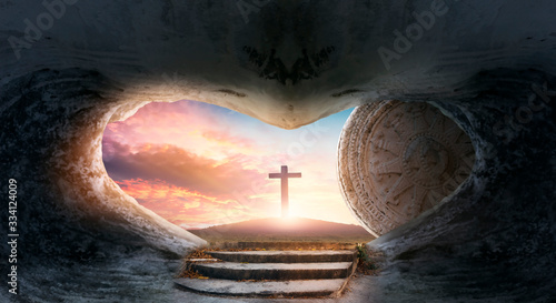 Photo Easter concept: Empty Tomb Of Jesus Christ At Sunrise With  Cross background