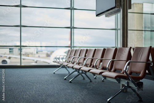 Fotografie, Tablou Empty airport with blurred plane on a background