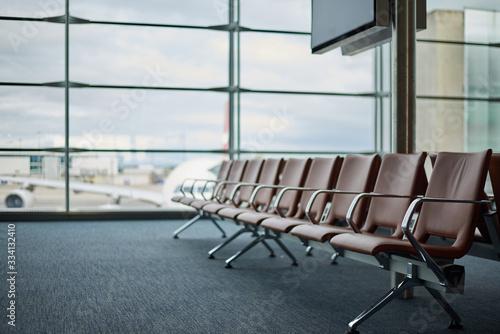Obraz Empty airport with blurred plane on a background - fototapety do salonu