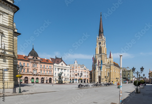 Fotomural Novi Sad, Serbia city center with cathedral and old buildings with small group of people almost empty during the coronavirus or covid-19 isolation