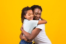 Black Mother Hugging With Her ...