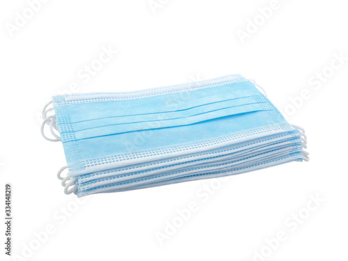 Foto close up stack light blue surgical mask (medical face mask) with white rope strap for protective coronavirus (COVID-19) pandemic or PM2