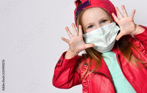 Fototapeta Potrait of playing blond baby girl in bright casual clothing wearing medical mask during coronavirus epidemic obraz