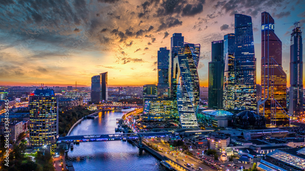 Fototapeta Moscow city skyscraper and skyline architecture, Moscow international business financial office with Moscow river, Aerial view skyscraper of Moscow City business center in autumn season, Russia.