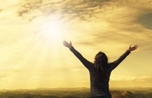 Woman With Open Arms Raised At...