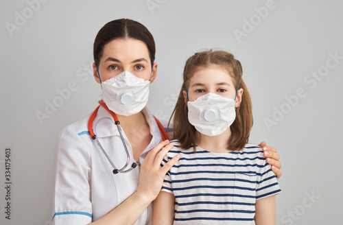 Fototapeta Doctor and child wearing facemasks obraz