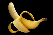 Half Peeled Ripe Banana, Isolated On Black Background