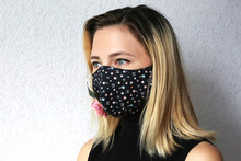 Woman Wearing Face Mask Decorated With Flowers. Stylish Handmade Cotton Mask.