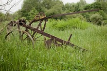 Beautiful Shot Of A Rusty Farm Plow In The Farm Of Saint Michaels, Maryland, USA