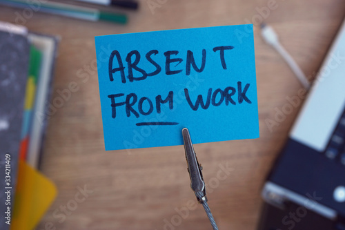 Absent from work written on a memo Canvas Print
