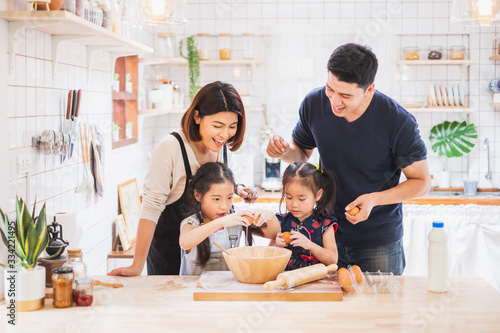 Obraz Asian family enjoy playing and cooking food in kitchen at home - fototapety do salonu