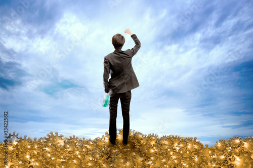 Man with medical or hygienic mask standing over dead Corona virus raised their h Tablou Canvas