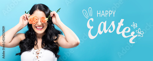 Fototapeta Happy Easter message with young woman holding carnation flowers obraz