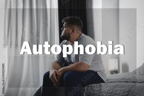 Fototapeta Depressed overweight man sitting alone on bed at home. Autophobia obraz na płótnie