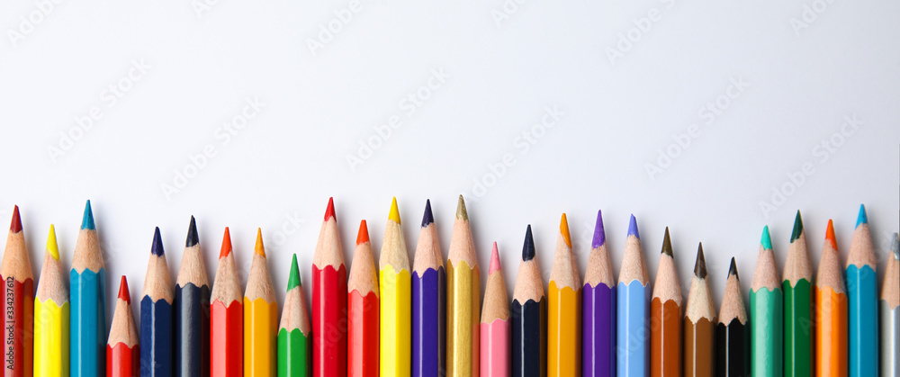 Fototapeta Color pencils on white background, top view with space for text. Banner design