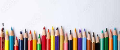 Color pencils on white background, top view with space for text Fototapet