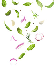 Basil Leaves And Other Ingredients Falling On White Background