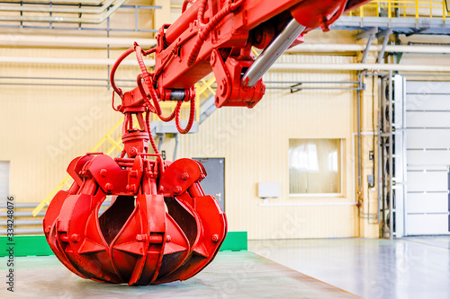 Red hydraulic steel grab clamshell bucket Fototapeta