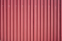 Closeup Of Red Corrugated Steel Panel