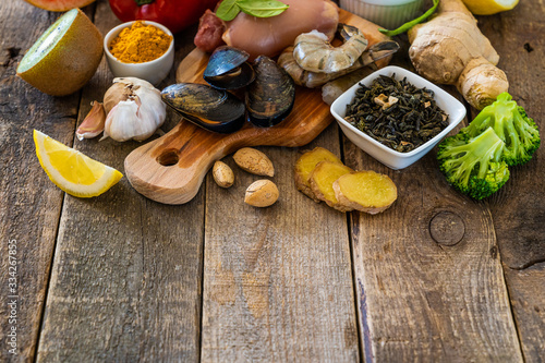Fototapeta Selection of food to boost immune system - healthy, rich in vitamin and antioxidants, copy space obraz