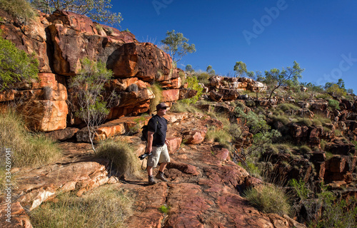 Vászonkép Nature photographer on a hiking trip at the Australian outback at rocky environm