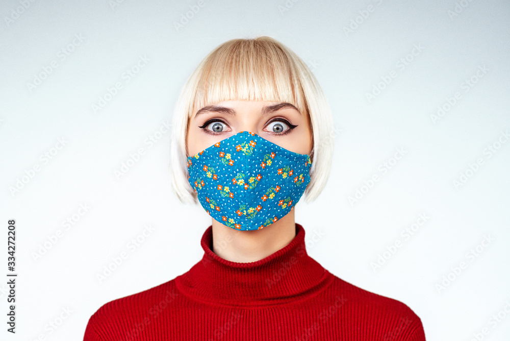 Fototapeta Shocked, surprised woman wearing handmade face mask. Copy, empty space for text