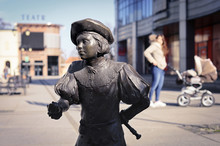 Inowroclaw, Poland - Bronze Figure Of A Medieval Student In The City Center With A Bokeh Background