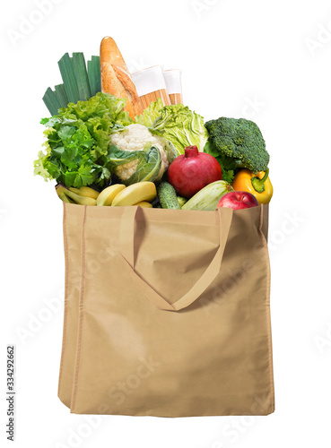 Photo Eco friendly reusable shopping bag filled with bread, fruits and vegetables on a