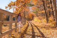 Woman Enjoying The Beautiful Fall Colors At Kancamagus Hwy In New Hampshire USA