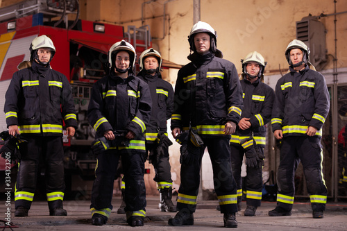 Fotografie, Obraz Six professional firefighters posing together