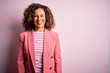 canvas print picture - Middle age beautiful businesswoman wearing elegant jacket over isolated pink background with a happy and cool smile on face. Lucky person.